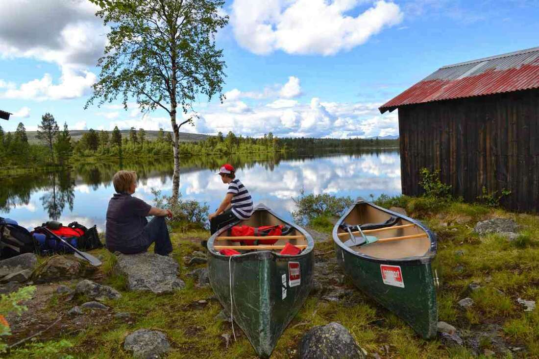 Penny and Toby Hawkins canoeing in Sweden