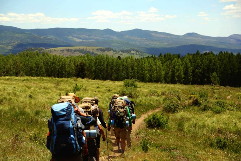 Backpackers following a trail