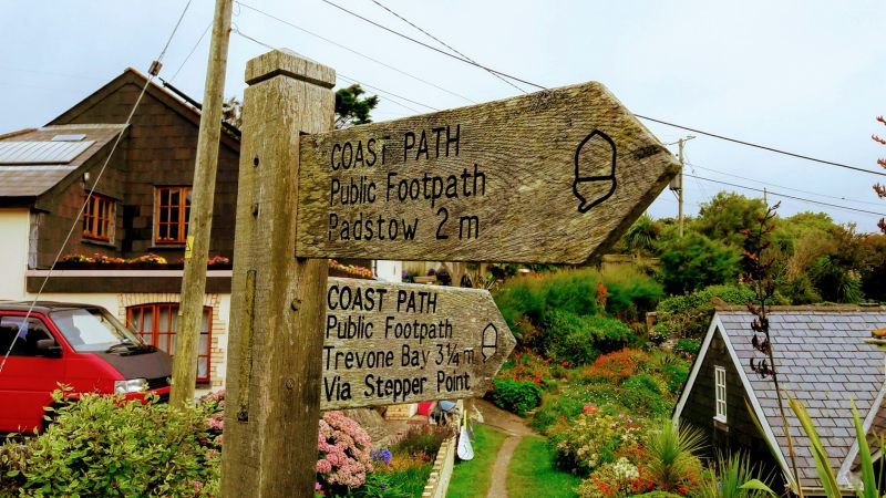 Signpost showing coastal path Hawker's Cove